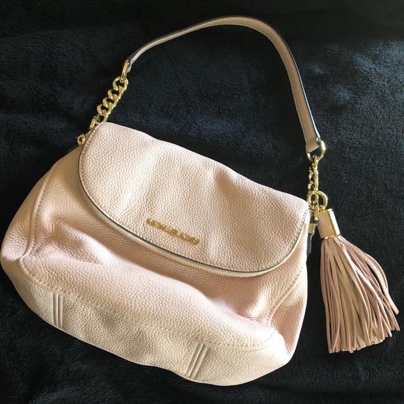 69d8fefad068db MK Bedford Tassel Convertible Shoulder Bag. M_5a9c43093afbbdfb91b6b42a.  Other Bags you may like. Michael Kors Gray crossbody